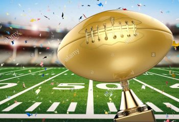 3d-rendering-golden-american-football-trophy-with-football-field-background-HTM6HP